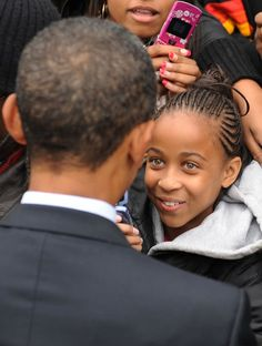 President Obama greets a young girl at a rally during his first presidential campaign on October 2, 2008, at Michigan State University.