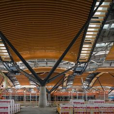 An interior view of the new Hong Kong Boundary Crossing and its waveform roof. The project is intended to provide Hong Kong with an architectural front door that celebrates travel. The roof has been fabricated using offsite construction to achieve high quality standards and be more environmentally-friendly. #rshp #architecture #hongkong #timberbuilding