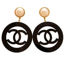 """Authentic Rare - Impossible to Find Chanel earringsPearl Clip on earrings with Lucite Logo HoopsCondition : Near Mint ConditionComes with Chanel BoxLength is 1.7cm(0.67"""") 2.2cm(0.87"""").Year 1988* All prices in US Dollars* Shipping Approximately 7-14 days WORLDWIDE -$20 USD* Payment is by PAYPAL*All DESIGNER items for sale are 100% Original and AuthenticPlease note: As with all vintage or new items there may be imperfections"""