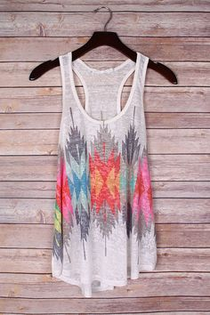 Lightweight knit white tank featuring a colorful Aztec feather print on the front and back. Fit Tip: True to size Made in USA 20% Rayon, 80% Polyester Hand wash