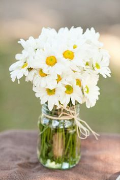 Daisies in mason jar is my favorite kind of bouquet!..... Came home to one on my dining room table.... So sweet!