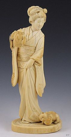 """Japanese Carved Ivory Geisha & Kitten Figurine. Meiji period. Signed to base. 5 1/4"""" tall"""