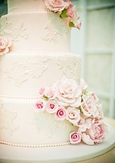 the way i want the flowers down the side of our cake but with piping designs instead of lace designs