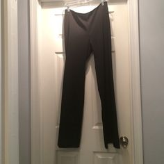 "Juniors black dress pants Black bootcut dress pants. GREAT CONDITION! Only worn a couple of times. Subtle black pinstripes. Zippers up the back, not in the front. Juniors size 9/10. Inseam is 31"". Pants"