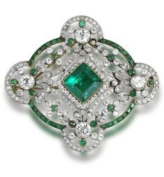 A Belle Époque emerald and diamond brooch/pendant, circa 1910.
