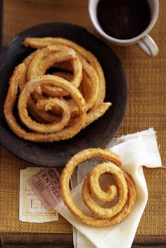 """""""Churros"""" are simple fried pastries that look something like a big """"French fry,"""" but taste nothing like one, of course. Fresh dough is squeezed through a pastry bag right into hot oil to fry. Once removed, they are cut into lengths and sprinkled with sugar or drizzled with honey and eaten hot."""
