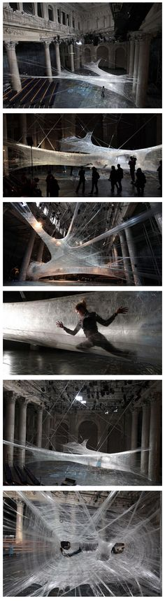 cocoon-like interactive installation made completely out of packing tape by use/numen