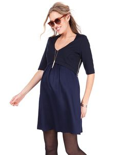 Fitted Ponte bodice Discreet side zip nursing access Woven a-line skirt 3/4 length sleeves V neckline   A must-have day to night style, our Ponte & Woven Navy Blue Maternity & Nursing Dress is ideal before, during & after pregnancy. The stylish fitted bodice is made in premium Ponte di Roma, finishing at the empire waist to define your slimmest point throughout pregnancy. While the soft woven skirt drapes beautifully over your curves to create a flattering A-line silhouette....