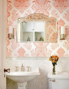 coral pink patterned wallpaper and pearly tiles