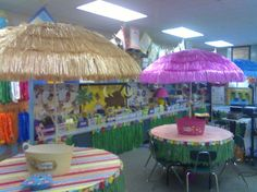 I love this beach theme and the use of the grass skirts to cover the cupboards and storage area below.  So creative!