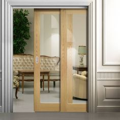 Deanta Twin Telescopic Pocket Walden American Oak Veneer Doors - Clear Safety Glass - Unfinished.    #glazedpocketdoors  #pocketdoors  #telescopicdoors