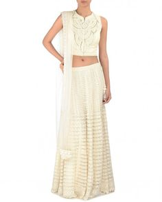 Ivory lengha with lace panels. Pearls embellished waistline with pink pompoms. This set also includes matching sleeveless blouse featuring beads, sequins and pearls. Round neckline with hook placket. Padded bustier. Matching crochet border dupatta includedWash Care: Dry clean onlyClosure of lengha: Zip at side