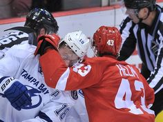 Lightning's Ondrej Palat and Wings' Darren Helm fight