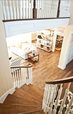 stairs were created on site, but the rest of the floor is a 3/4″ pre-engineered hardwood from Kentwood.