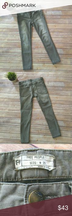 Free People grey skinny jeans.  Size 28 Free People skinny jeans.  They are a grey color with fading on the front of the thigh area.  These are about ankle length.   Rise: 8 inches  Inseam: 26 inches Waist: 15 inches laying flat Free People Jeans Skinny