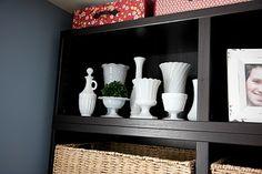 displaying milk glass on book shelf