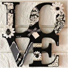 wood letters, scrapbook paper for decor..add flowers with hot glue
