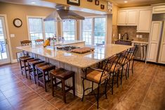 This remarkable kitchen has maple cabinets with presidential doors. A wall was removed to make way for the large island. The island seats 12 or more and features a hibachi cooktop and range hood.