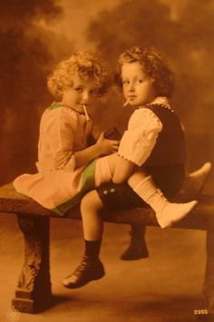Little boy and girl smoking Pictures postcards
