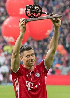 Robert Lewandowski of Bayern Muenchen pose with the 'Torjaegerkanone' trophy as best goalmaker of the Bundesliga season after the Bundesliga match...