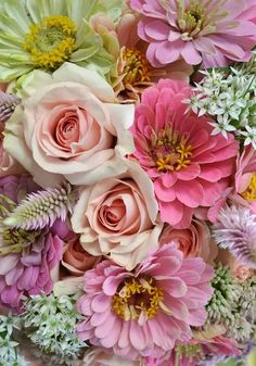 A lovely mix of pastel flowers for fall (don't be fooled by the colors - these aren't spring flowers!). Zinnias, roses, sedum and upright amaranthus.