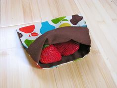 "My favorite! Fold over reusable snack bags. No need to have plastic bags again. For real ""green"" living try to find organic cotton/hemp fabric for the lining."