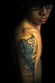 """this is my second tattoo. by ian cabrido at cebu city philippines.  its actually about notes and music,the text """"PEDRO"""" is the name of my grandfather who just passed away the day i had this tattoo."""