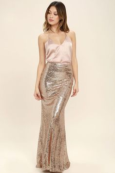 Lulus Exclusive! The Effervescent Evening Gold Sequin Maxi Skirt is sure to show off your bubbly personality! Woven poly is decorated with a sea of sparkling sequins that bedazzle from the high, fitted waist, down to the flaring maxi hem. Hidden zipper/clasp at back.