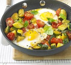One-pan summer eggs. splash olive oil in pan. add 2 courgettes diced. fry, stirring occasionally until they start to soften. add 7 oz cherry toms, halved & 1 clove garlic, crushed. Season. make gap in mix & crack 2 eggs in. put lid or foil on top. cook 2-3 mins until eggs done to your liking. Scatter fresh basil if wanted.