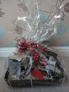 Over the years that I've been wrapping gift baskets I've found this way to be the best for wrapping large baskets in cellophane. It doesn't...