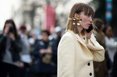 Anya Ziourova wearing a Rosie Assoulin statement earring