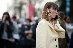 Anya Ziourova wearing a Rosie Assoulin statement earring