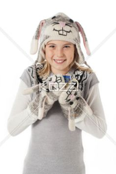 portrait image of a teenage girl wearing rabbit costume holding a coffee mug. - Portrait image of a teenage girl wearing rabbit costume holding a coffee mug over plain white background. Model: Shania Chapman - Agent is Breann at MMG. breann@nymmg.com