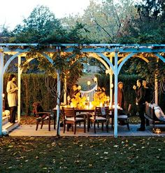 Extended Coverage- A long pergola shields the outdoor living and dining area from the sun's glare and serves as a framework for sparkling lights at night. The outdoor living space fits comfortably between the house at one end and the outdoor fireplace at the other.