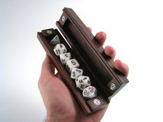 I have one of these, and I love it! Wyrmwood Gaming Dice Vault! A handmade dice case for tabletop RPG players, finely crafted in a variety of premium woods by the craftsmen at Wyrmwood Gaming.