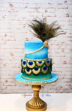 A peacock themed cake for the occasion of first birthday celebration . The feathers in bottom tier hand painted with actual feathers in the top tier . The theme is very Indian representing Indian culture and a symbol of Lord Krishna. Peacock Birthday Party, Baby Boy 1st Birthday Party, Birthday Themes For Boys, Themed Birthday Cakes, Themed Cakes, Birthday Celebration, Cake Designs For Kids, Cupcake Cake Designs, Beautiful Birthday Cakes