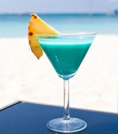 Signature Wedding Cocktails: Blue Caribbean Drink Recipes Cravelocal.com  Blue Pina Colada Martini  2 oz. Azzurre Vodka 1 oz. coconut rum 2 oz. pineapple juice 1 oz. cream of coconut 1/2 oz. blue curaçao Garnish with a pineapple slice Directions:  Combine vodka, rum, pineapple juice and cream of coconut in a cocktail shaker filled with ice. Shake well and strain into chilled martini glass. Garnish with a pineapple slice. Add beach sand, tropical music, and sail away!