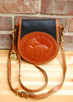 """Vtg. Dooney & Bourke Duck Bag in Black and Tan, RARE // Small Leather Crossbody Satchel Bag, """"Big Duck"""" Style // Excellent Vintage Condition on Etsy, $164.00"""