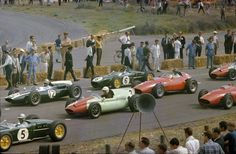 Zandvoort June 5, 1960 Jim ( Nr 6 ) getting ready to start in the midfield. The grid shows: 5 Alan Stacey Lotus 18, 12 Bruce McLaren Cooper T53, 9 Tony Brooks Cooper T51, 3 Richie Ginther Ferrari 246, 1 Phill Hill Ferrari 246 and the nose of the Cooper T51 of Henry Taylor (10)
