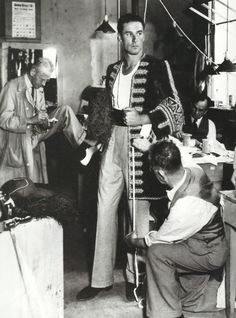 Errol Flynn getting measured for his outfit for Captain Blood.