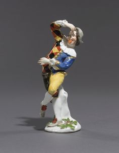 A rare Meissen figure of Harlequin with a snuffbox, modelled by J.J. Kändler, circa 1738-1740.