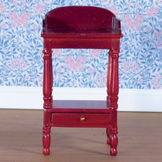 """""""Mahogany"""" wash stand. Mildly annoying because wash stands tended to be tiled or made of light coloured wood that wouldn't be damaged by water marks. Plan to use this as a stand for the father's shaving things."""