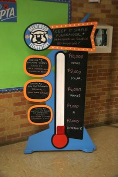 A gift to our local elementary school. A toilet paper roll holder on the back holds a strip of red felt that sticks to the Velcro on the white part of the thermometer. PTA did a great job painting it. Pta School, School Fundraisers, Sunday School, School Auction, School Fundraising Ideas, Goal Thermometer, Fundraiser Thermometer, Kindergarten, Fundraising Events