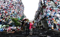 Disposable Fashion:  M covered buildings and filled London's Brick Lane Fashion District with the equivalent amount of clothing that we throw away every 5 minutes-- 10,000 items, that is outrageous!