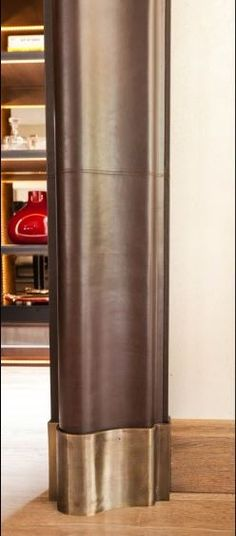 Leather and metal door architrave