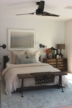 I love the blues with the dark wood. I would take this bedroom!! :)