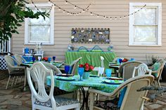 Patio party (for a 25th wedding anniversary).  Like how they strung the lights, brought indoor chairs out, and created a dessert table.
