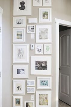 Frames in white on a grey wall.