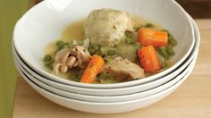 """Few recipes scream """"comfort food"""" like chicken and dumplings. This hearty recipe combines chicken thighs, plump dumplings, and plenty of vegetables for a meal that's warm and filling. These chicken and dumplings are ready in just an hour, so they're totally doable for busy weeknight meals."""