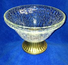 """Vtg. Hosley 6"""" Crackle Glass Brass Base Bowl~ Candle Holder /Candy Dish~ INDIA $7.99 + 9.89 SH Vtg 6"""" crackle glass with a brass base bottom. It can be used as a candle holder, candy dish or a decorative bowl. The top measures 6"""" and the bottom of the base measures 3 1/8"""" wide. It is in excellent condition with the only wear on the bottom. The felt has opened by edge but is not visible when upright and does not effect piece. It has a pen tip bubble hole on inside from manufacturing."""